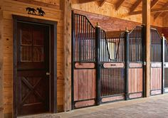 Office or tack room maybe? Love the names on the stall doors.