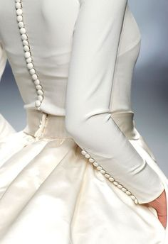 My wedding dress had buttons just like this and a button hook tool to close all of them down the back and sleeves. What a job Cj