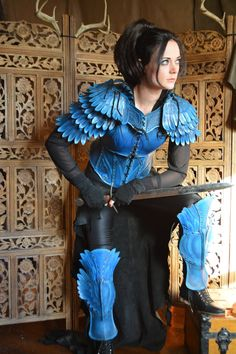 Finally got a few respectable pictures of this armor! The lady's Bluejay Armor is made from hardened veg-tan leather, hand-tooled and painted.
