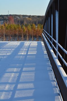 Snow covered bridge at #dftrees