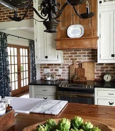 home accents kitchen love love love white cabinets, brick and wood accents! Kitchen Redo, New Kitchen, Kitchen Remodel, Kitchen Dining, Kitchen Brick, Kitchen Ideas, Kitchen Inspiration, Kitchen Lamps, Kitchen Cabinets