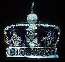 The Imperial State Crown made in 1937 for King George VI and similar to the diamond crown made in 1838 for Queen Victoria. The present Crown is made of gold and includes four crosses pattée and four fleurs-de-lis, with two arches on top, surmounted by a cross pattée. The Crown jewels: 2,868 diamonds, 273 pearls, 17 sapphires, 11 emeralds, and five rubies. Among the stones are several famous ones, including the Black Prince's Ruby and the Cullinan II diamond as the Lesser Star of Africa.