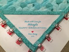 Mikayla's Graduation Quilt - Simple label hand sewn in with the binding in the corner.