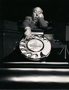 Alfred Hitchcock and the telephone prop from 'Dial M For Murder' (1954)