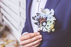 Special autumn wedding boutonniere. Details of berries, brunia, ornithogalum, rose and a scent of anise