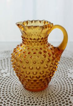 Vintage Amber Hobnail Glass Pitcher Ruffled Top Fenton. $18.00, via Etsy.
