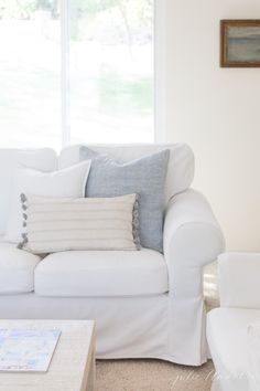 Lake Cottage Before and After White slipcover sofa with light blue accent pillows + chambray pillow + light wood coffee table + warm white walls Master Bedroom Set, King Bedroom Sets, Home Living, Living Room Sofa, Living Rooms, Light Blue Sofa, White Light, Cosy Home, Lane Furniture