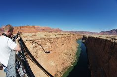 Navajo Bridge, Marble Canyon, AZ The company Bungee Expeditions operates a non-permanent jump site on the Navajo Bridge, which launches from a height of 142m (467ft) above the Colorado River, near the North Rim of the Grand Canyon