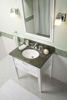 Simple Bathroom Makeover  Granite vanity tops cost as little as $150 and come complete with an under-mounted sink.