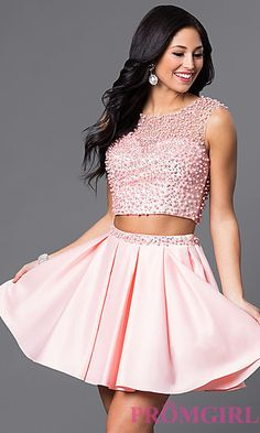 This homecoming 2016 two piece makes us blush! Short two piece homecoming dress with a sleeveless sheer illusion bodice embellished with beads and rhinestones has a short box pleated skirt with embellished waistband.