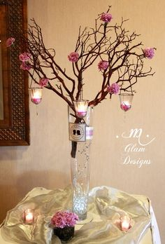 I like the top part of this centerpiece...not a big fan of when you can see the bottom of the branch like this