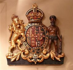 Queen Alexandra's Coat of Arms. The Arms are the British Royal Family's with the Danish Royal Arms impaled (the smaller crest within the main one, on the right hand side) The Lion is taken from the British Coat of Arms and the 'Norseman' (who has discoloured with time) from the Danish. Circa 1905. Dimensions 88 cm/34¾ inches (width) x 94 cm/37 inches (height).