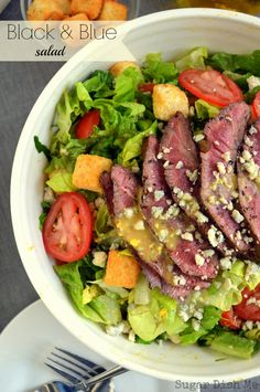 Crisp romaine lettuce tossed in homemade Caesar dressing, topped with blackened flank steak, tomatoes, blue cheese, and bacon.