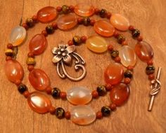 Red Aventurine carnelian and tigers eye necklace with large flower toggle clasp by 3CedarsJewelry for $62.00