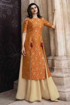 This Banarasi Jacquard And Satin Orange And Cream Colour Kurti Is The Fun Attire Of The Moment. Get It and Style It With Handbag and Earrings For The Perfect Day Look. Its Party Wear and Cute - The. Dress Neck Designs, Kurti Neck Designs, Blouse Designs, Salwar Designs, Latest Kurti Designs, Stylish Dresses, Fashion Dresses, Fashion Clothes, Indian Gowns