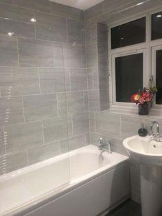 Silverstone Grey Gloss Wall Tiles - Silverstone from Tile Mountain Grey Bathroom Wall Tiles, Gray Shower Tile, Bathroom Renos, Bathroom Tile Designs, Large Tile Shower, Bathrooms Decor, Small Grey Bathrooms, Upstairs Bathrooms, Gray And White Bathroom Ideas
