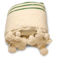 Hand loomed, 100% lambswool bed cover with pom poms.