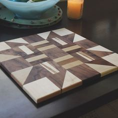 My Mom has been visiting and while I've been busy working on other things, she's been busy quilting. I saw a pattern she was working on and felt inspired to turn it into a block of my own. #woodworking #maple #walnut #woodquilt #quiltblock #cuttingboard #woodart #wood #quilting #mrfixitdiy  #woodshop #craftsman