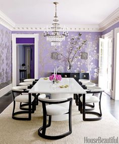 For this Massachusetts house, designer Mary McGee designed a bold lacquered table and contemporary chairs that contrast with the delicate hand-painted Chinese wallpaper by Gracie.