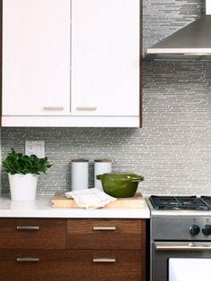 modern white upper cabinets and warm wood on the lower cabinets, white countertop and tile backsplash