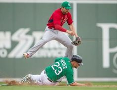shortstop Pete Kozma turns a double play in a spring training game with the Boston Red Sox. Cards lost 10-5.  3-17-14