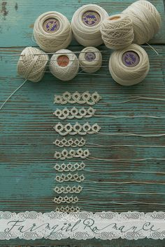 Very cute picture of bits of tatted lace in different sizes/threads. Tatting needles too. :D