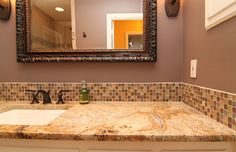 x This vanity has a lot of room for the lady of the house! Beautiful counter top with matching mosaic back splash.