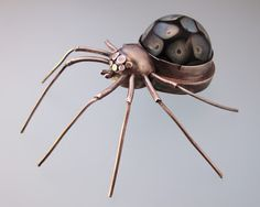 Dana Stenson Jewelry and Metalwork.  Custom spider by dana with a glass cabochon made by Sarah Bookbinder.