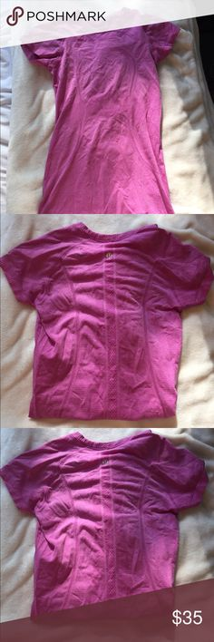 Pink lululemon workout top. Cute gently worn pink lululemon workout top! Took the tags off but it is either a 0 or size 2 lululemon athletica Tops Tees - Short Sleeve