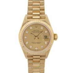 This beautiful Pre-owned Rolex women's 18 Kt yellow gold Datejust President features a champagne diamond dial for a stylish and elegant look. Case: Rolex 18 Kt yellow gold Caseback: 18 Kt yellow gold