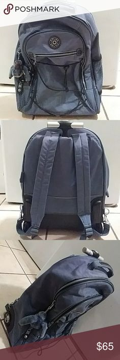 Kipling backpack Nice blue backpack. Have wheels for easy transport. Very spacious, many compartments, extendable handle. Minor stains shown in picture on front of the bag along with minor wear. Perfect for a busy highschooler.!!!!! Kipling Bags Backpacks