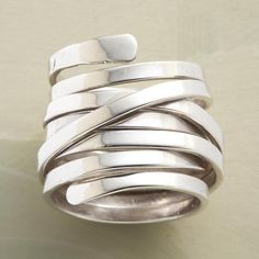 WRAPAROUND RING - Add a touch of elegance to any outfit with this sterling silver wraparound ring.