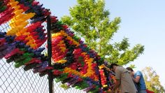 Kids, Parents and Teachers Join Forces to Create a Colorful Installation with 2,100 Plastic Bottles