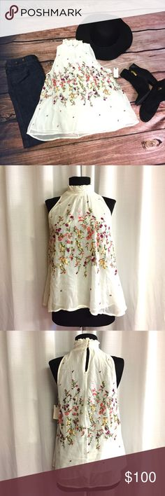 Anthropologie Floral Embroidered Top Floral✔️ Embroidered✔️ Flowy✔️ This top has it all! It's 23 inches long with a 20 inch waist and a 17 1/2 inch chest. It has a high neck with a 3 button closure on back. The neck is 7 inches across with a keyhole opening on the back. It's sheer with the most beautiful embroidered flowers. This top will be the perfect finishing touch to any outfit. Anthropologie Tops Blouses