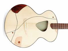 Awesome Swiss made acoustic guitars. They are built by luthier Claudio Pagelli and his wife Claudia is responsible for the designs. Claudio is in the guitar building business since 1977. see: http://www.pagelli.com/index.html . Here are some pics of acoustic guitars and of an archtop guitar.