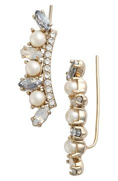 A gently curved line of twinkling crystals and lustrous faux pearls add edgy elegance to these modern ear crawlers.