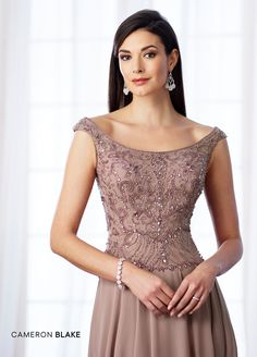 mon cheri bridals 217635 - Tip-of-the-shoulder chiffon A-line gown with tapered shoulder straps, front and back scoop necklines, hand-beaded bodice, scalloped natural waist, softly gathered skirt with sweep train. Matching shawl included.