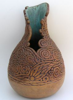Tan Coiled Vase With Turquoise Throat. $950.00, via Etsy.