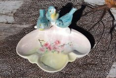 30s Art Deco Czech Porcelain Trinket Dish. Adorable trinket dish likely, originally an ashtray has three figural blue birds with yellow bellies perched on the edge. I can almost hear them singing their Spring songs! The dish is scallop shape and has a shallow bowl with hand painted pink blossoms. #ashtray #czechpottery #trinketdish #artdeco