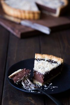 This Bittersweet Chocolate Tart with Toasted Coconut and Sea Salt: rich, decadent and perfect for parties - people will beg you for the recipe | savorysimple.net