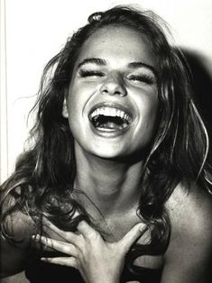 This is how i look when i laugh! But just not near as high class:) mouth open.. Head thrown back.. Hair in wild disaray!!! YIKES