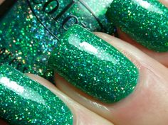 Holiday Splendor..  green, silver and holo glitter in a medium green jelly base
