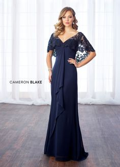 Cameron Blake 217643 - Lace and chiffon slim A-line gown with front and back hand-beaded V-necklines, attached scalloped lace and hand-beaded capelet, center gathered sweetheart bodice with empire waist finished with cascading center front ruffle, sweep train.