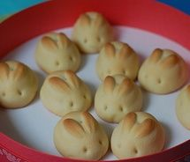Biscuit Bunnies (Make the little ears by snipping the bread dough with scissors while the dough is rising, then poke two holes for the eyes.)