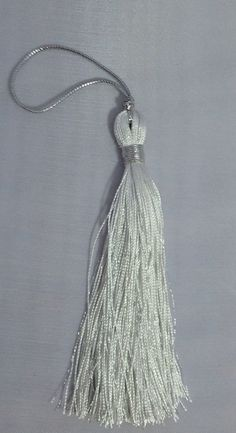A personal favorite from my Etsy shop https://www.etsy.com/listing/209489151/metallic-silver-thread-tasselwhitesilver