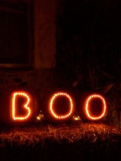 Letter Pumpkins by amyland.org. Drill holes and push white Christmas lights through.