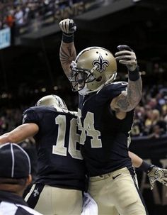 New Orleans Saints wide receiver Kenny Stills (84) celebrates his touchdown reception with wide receiver Lance Moore (16) during the second half of an NFL football game against the Buffalo Bills in New Orleans, Sunday, Oct. 27, 2013. (AP Photo/Bill Haber)