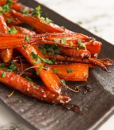 These Honey Balsamic Roasted Carrots are beautifully caramelized in a sweet and sticky glaze. The perfect side dish for your Sunday roast. Balsamic Glazed Carrots, Honey Glazed Carrots, Honey Roasted Carrots, Cooked Carrots, Carrots Side Dish, Cooking Carrots In Oven, Honey Balsamic Glaze, Grilled Carrots, Veggie Side Dishes