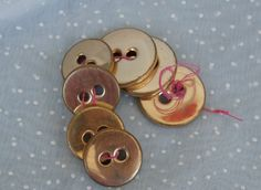7 Metal Buttons, Brass Color, 2 Hole - light weight, 2 sizes by MendozamVintage on Etsy