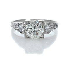i am in love with this art deco engagement ring